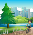 A boy biking across the tall buildings near the vector image vector image