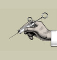 hand with a retro syringe vector image