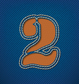 Number 2 made from leather on jeans background vector image vector image