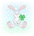 bunny holding clover leaf vector image