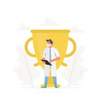 doctor stands in front gold trophy cup vector image