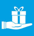 gift box in hand icon white vector image vector image