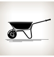 Silhouette a Wheelbarrow on a Light Background vector image vector image