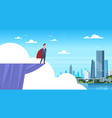 business man wearing red cape standing on mountain vector image