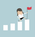 businesswoman holding a flag on top the graph vector image vector image