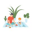 father with his son playing with toy car family vector image