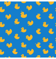 Cute pattern with yellow ducks on a blue vector image