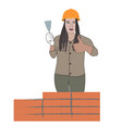 woman builder builds a house of brick flat vector image vector image