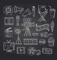 cinema doodle icons on black chalkboard vector image vector image