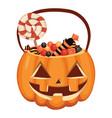 halloween pumpkin bucket filled with sweets vector image