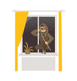 thief in mask breaking into house through window vector image vector image