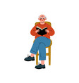 elderly man sitting on chair reading book senior vector image