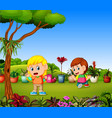 little girl watering plants and a boy planting vector image
