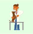 Eterinarian examining a dog vector image