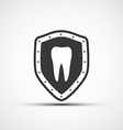 shield with a human tooth vector image