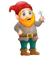 cartoon happy gnome holding a flower vector image