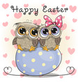 two cute owls are sitting on an egg vector image