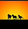 silhouette of three horses galloping at sunrise vector image