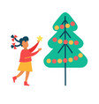girl decorates new year tree putting star on top vector image