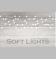 christmas lights on wood texture soft winter vector image vector image