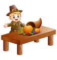 pilgrim boy with cornucopia of fruits and vegetabl vector image