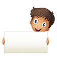 A smiling young boy holding an empty signage vector image vector image