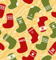 Seamless Christmas background with stockings vector image vector image