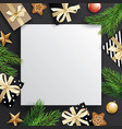 christmas tree branches and gift box with white vector image