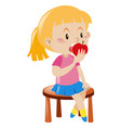 little girl eating apple vector image vector image