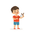 cute bully boy with a slingshot hoodlum cheerful vector image vector image