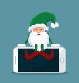 elf of santa claus sitting on top of cell phone vector image vector image