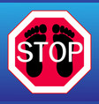 stop sign on with footprints vector image vector image