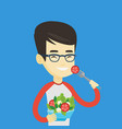 man eating healthy vegetable salad vector image