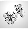 Two batterflies with floral black pattern vector image vector image