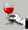 hand holding a glass with red wine vector image vector image