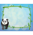A panda standing beside a bamboo frame vector image vector image