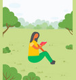 woman sitting on grass and reading book vector image