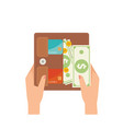 woman hands taking banknotes out from her leather vector image vector image