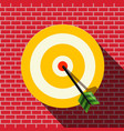 target with dart in the center bullseye on wall vector image vector image