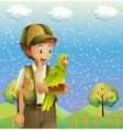 A boy holding a green parrot vector image vector image