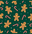 gingerbread man and candy cane green pattern vector image vector image