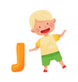 excited boy jumping near big alphabet letter d
