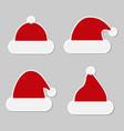 sticker red christmas hats christmas hats santa vector image