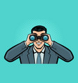 businessman looks at target through binoculars vector image