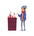 homeless man stands warming his hands fire vector image