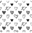 seamless pattern with black hand drawn hearts vector image