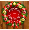 A Christmas wreath on wooden planks background vector image vector image
