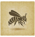 Honey bee silhouette on vintage background