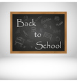 Back to School text on black wooden chalkboard vector image vector image