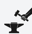 hand with hammer above anvil vector image vector image